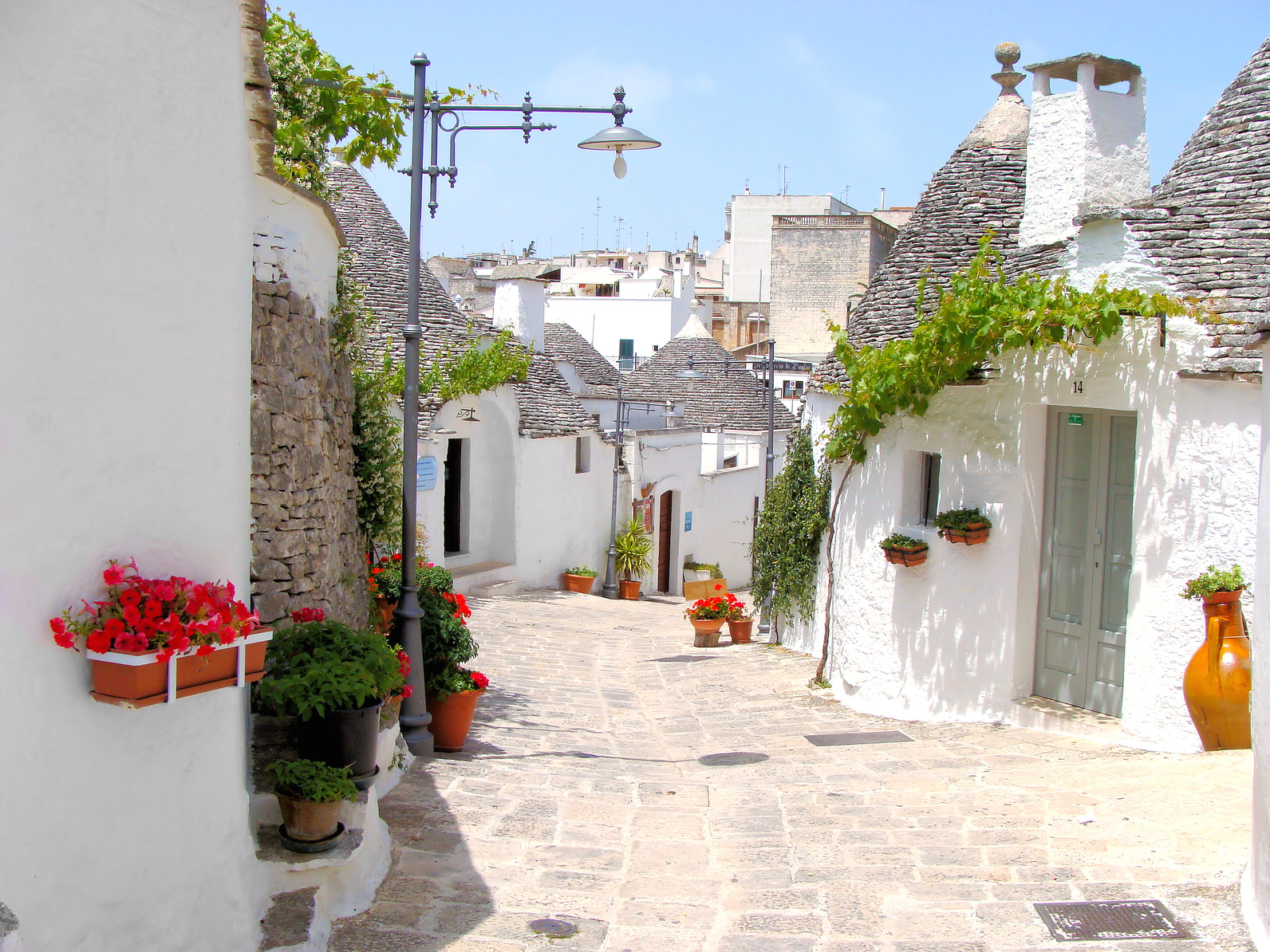 Pretty street among the trulli of Alberobello, Italy